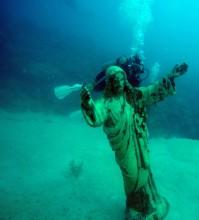 behind jesus statue